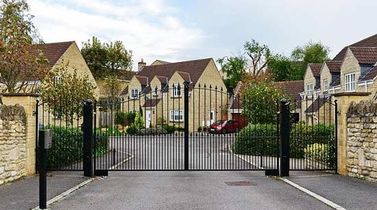 front-gate-of-subdivision-with-well-managed-grounds